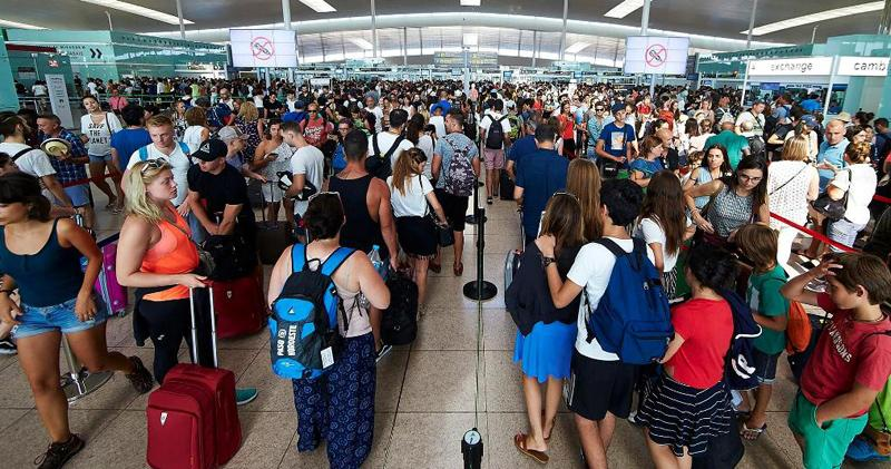 Travellers queue at the security checkpoints at Barcelona-El Prat airport, Spain. Pic: Alejandro Garcia/EPA