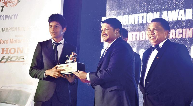 Aaron Gunewardena receives the award on behalf of his brother Jaden who was declared as the most outstanding rider young Rider during the Super Series - 2017 from State Minister for Defense Ruwan Wijewardene.