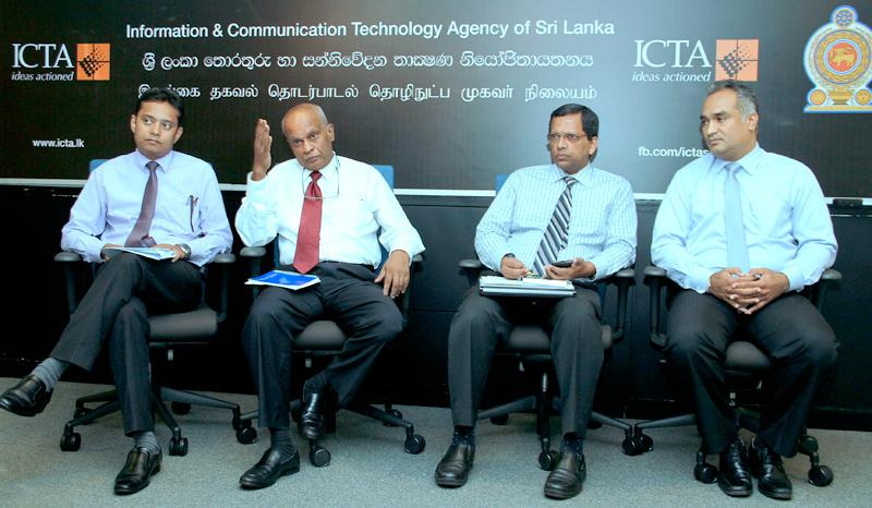 ICTA CEO (Acting) Dr. Ajith Madurapperuma (second from left) addressing the media. Officials of ICTA are also in the picture.