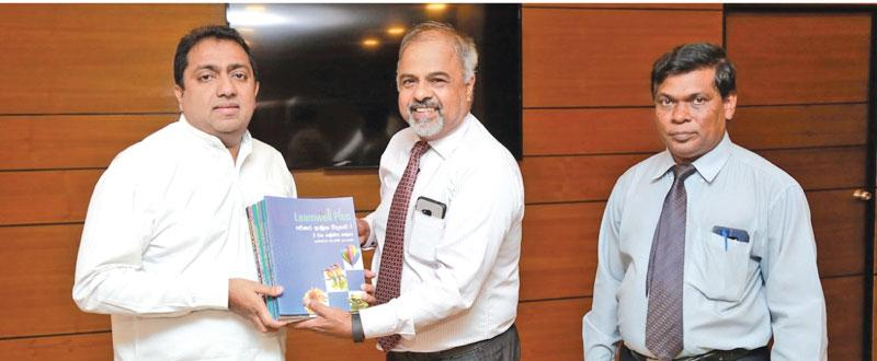MBD's Sri Lanka Country Manager Jayampathy Arambepola hands over the books to Minister of Education Akila Viraj Kariyawasam. Director of Science of the Ministry of Education, Mr. Wipulasena is also in the picture.