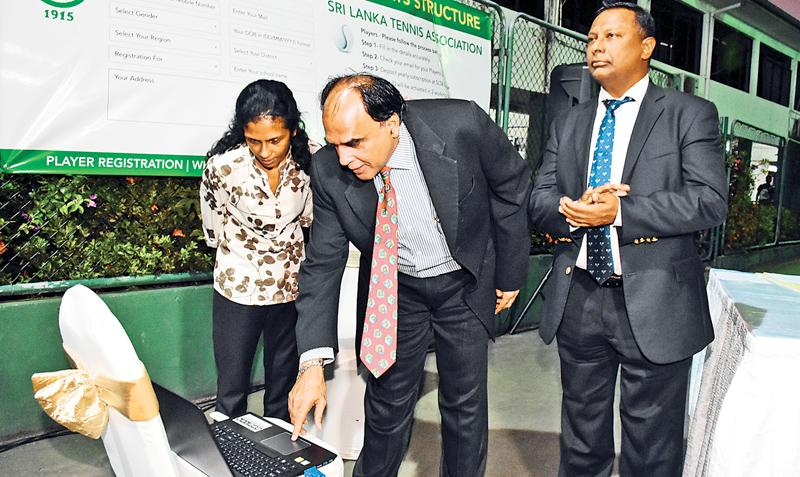 President of the Sri Lanka Tennis Association launching the website for the SLTA watched by Suresh Subramaniam and Zarina Raheem.