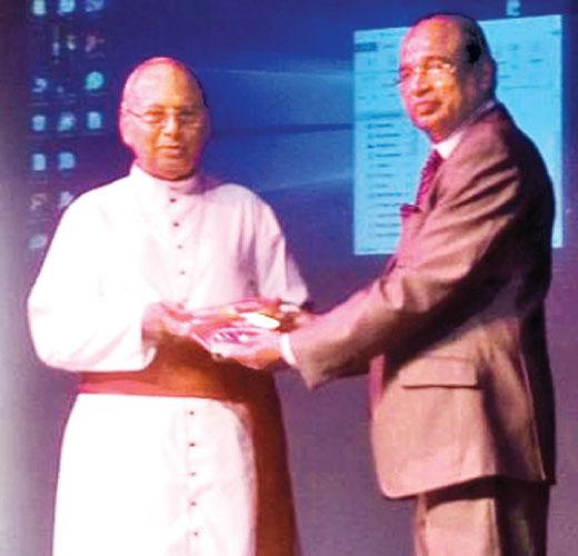 Archbishop of Colombo His Eminence Malcolm Cardinal Ranjith and Senior Attorney-at-Law Godfrey Cooray