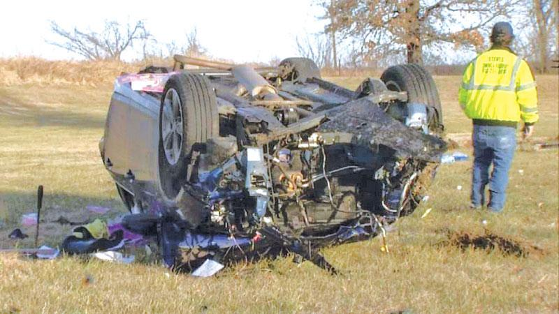 The badly damaged sedan, with debris - and engine parts - strewn around the field where it wrecked.