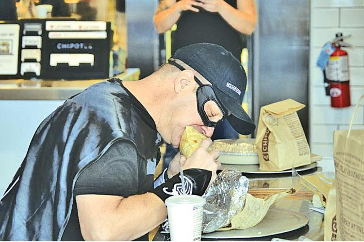 Bruce Wayne of Tiffin, Ohio enjoys his 426th consecutive  Chipotle meal. To celebrate, Chipotle presented Wayne with his own Chipotle-inspired superhero gear, complete with a cape and mask.  Business Wire