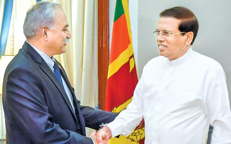 High Commissioner of Pakistan Dr. Shahid Ahmad Hashmat  shake hands with President Maithripala Sirisena