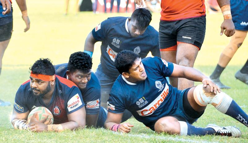 Gayan Jayamaha scores a try for CR&FC in their Dialog 'A' division league rugby match against Police SC played at Police Park yesterday. (Pic by Saman Mendis)