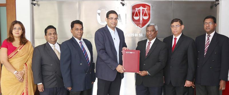 CA Sri Lanka President Lasantha Wickremasinghe exchanges the agreement with ICCSL Chairman Dinesh Weerakkody