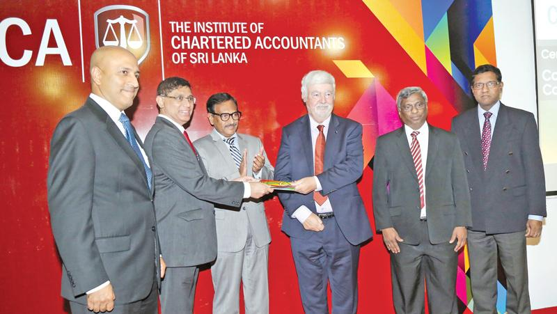 CA Sri Lanka President elect Jagath Perera presents a copy of the Code to Prof. Barry J. Cooper. Lasantha  Wickremasinghe, Asite Talwatte, Aruna Alwis and Prof. Gishan Dissanaike (of the University of Cambridge) look on.
