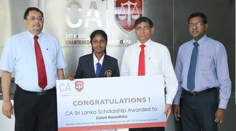 CA Sri Lanka President Jagath Perera presents the scholarship to Ms. Dulani Rasanthika of Sujatha Balika Vidyalaya, Matara, who was adjudged all-island first in the commerce stream at the 2017 GCE Advanced Level exam. Also in the picture are CA Sri Lanka's Vice President Manil Jayesinghe and CEO Aruna Alwis.