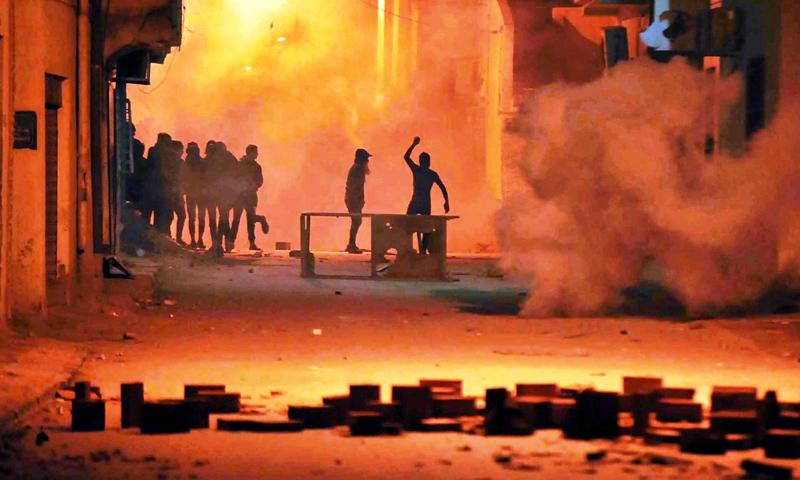 Protesters clash with Tunisian security forces in Tebourba on Wednesday.Pic: STR/EPA