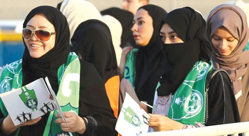 A Saudi woman is seen during the soccer match between Al-Ahli against Al-Batin at the King Abdullah Sports City in Jeddah, Saudi Arabia on Friday.