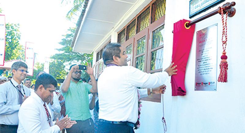 Director/CEO Kapila Ariyaratne unveils the plaque of 150th 'Seylan Pahasara' Library opening at C.W. W. Kannangara Vidyalaya, Colombo 8.