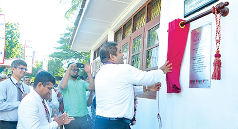 Director/CEO Kapila Ariyaratne unveils the plaque of 150th 'Seylan Pahasara' Library opening at C.W. W. Kannangara Vidyalaya, Colombo 8.