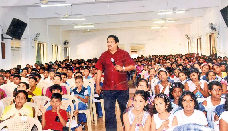Dr Rajiva Perera delivering his lecture
