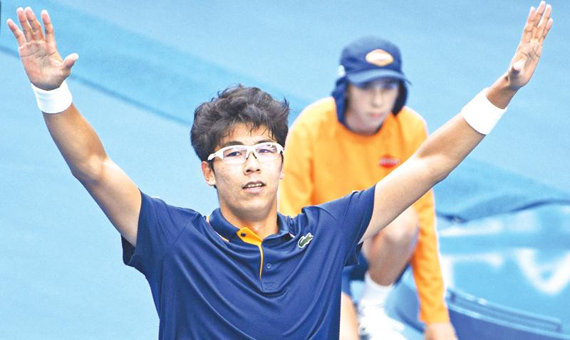 South Korea's Chung Hyeon celebrates his victory over Germany's Alexander Zverev in the third round of the Australian Open tennis championships in Melbourne on Saturday. AFP