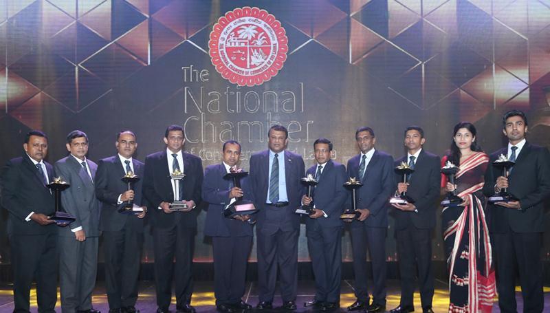 Team members of Kelani Valley Plantations with Managing Director Roshan Rajadurai, Director/CEO Sarath Siriwardena at the National Business Excellence Awards 2017