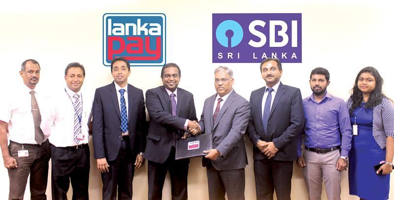 (From left) Head of Certification and Integration LankaClear Hemanthe Samaliarachchi, Head of External Services LankaClear Isuru Jayaweera, DGM IT & Operations LankaClear Dinuka Perera, GM/CEO LankaClear Channa de Silva, Country Head SBI Rajeev Srivastava, SVP Branch Head, Colombo Hemant Jaiswal,Vinoth and Taniya IT team SBI Sri Lanka