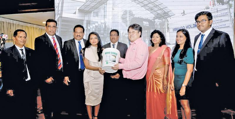 Director, Sketch Co. Ltd. Japan, Takaseki Yoshihiro handing over the Nano Shield thermal insulation product to Himaco Holdings Managing Director Shamara Ariyasena. Others from left are J.D.R. Sylvester, Sanjeev Mohan, Himako Holdings Chairman Himal Ariyasena, Marakkandu Moorthy, NilanthiAriyasena, IsharaAriyasena and BenukaAriyasena.