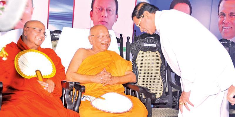 President Maithripala Sirisena pays obeisance to Ven. Prof. Bellanwila Wimalaratana Thera