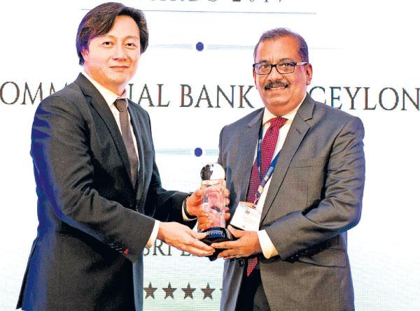 CCO Selva Rajasooriyar (right) receives one of the two awards presented to Commercial Bank by International Finance.