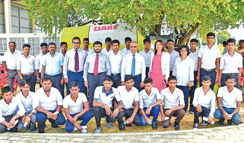 DIMO and Ministry of Skills Development and Vocational Training officials with the students of the second combined harvester training program.