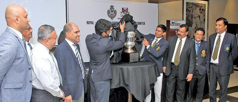 Captains of Royal College and Gateway Intl. College Tharindu Pasan and  Ishira Ritigahapola unveiling the Alles-Gunesekera Cup before handing it  over to the Principals of B.A. Abeyratne and Harsha K. Alles