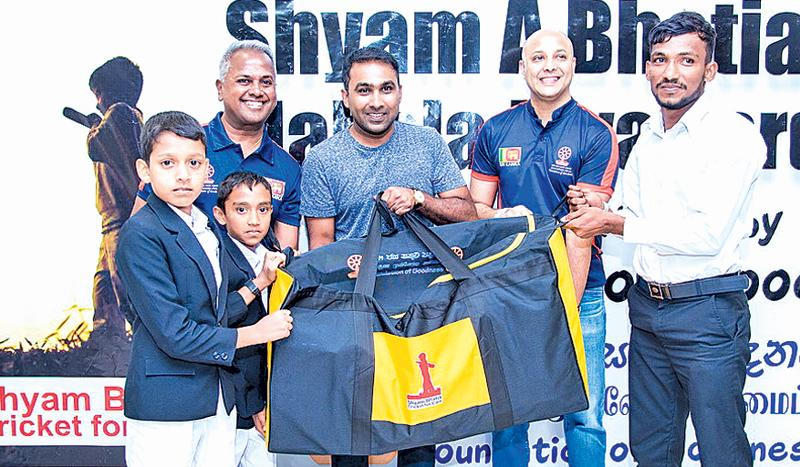 Former Sri Lanka captain Mahela Jayawardene, Ashan Malalasekera and Kushil  Gunasekera present cricket equipment bags to rural children.