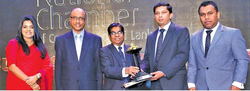 Chief Credit Officer Sasindra Munasinghe of CDB Finance PLC (second from right),  Deputy General Manager - Finance and Planning,  Hasitha Dassanayake and Aroshi Ranatunga, Head of Sustainability receive the  Non-Banking Financial Services Sector Gold Award at the National Business Excellence Awards 2017
