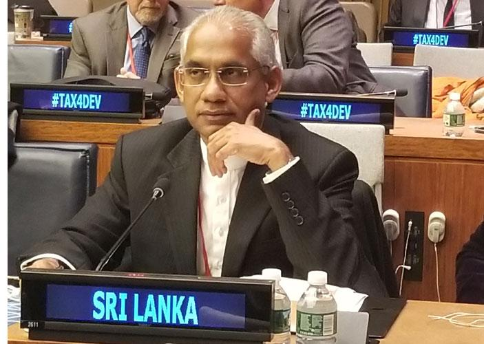 Minister Eran Wickramaratne at the conference