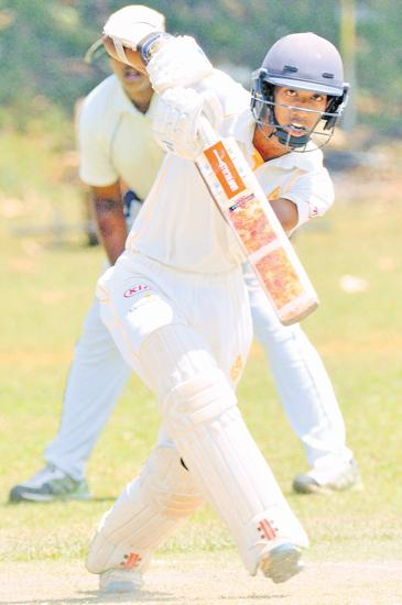 Kamil Mishra of Royal College drives for runs during his knock of 80 on the second day of their inter-schools cricket match against Wesley College at Campbell Park yesterday.  (Pic by Susantha Wijegunaseskara)