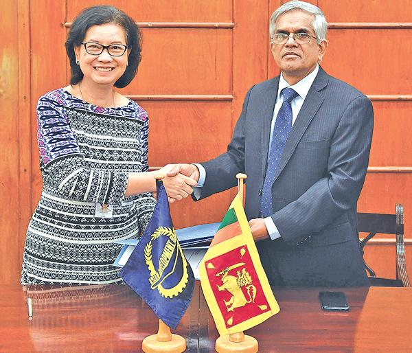Secretary Ministry of Finance and Mass Media Dr. R H S  Samaratunga and Country  Director ADB, Sri Lanka Resident Mission, Ms. Sri Widowati at the signing of the agreement.
