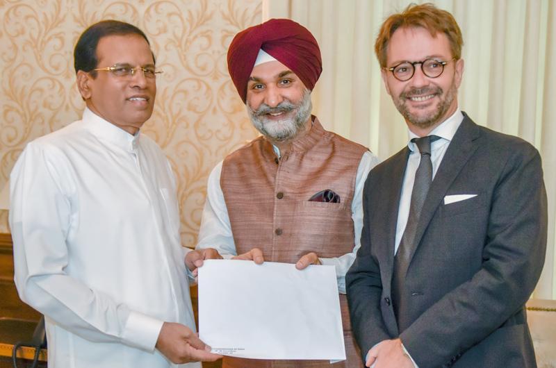 High Commissioner of India Taranjit Singh Sandhu and Ambassador of France Jean-Marin Schuh present the invitation to President Sirisena.