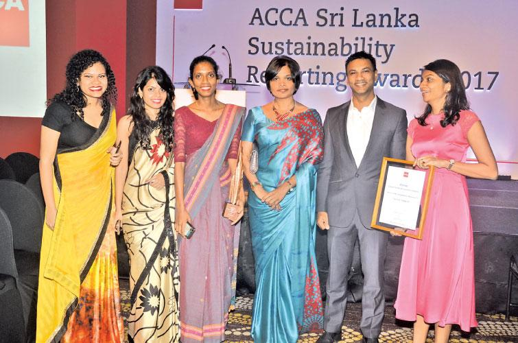 Women executives share joy after their company, John Keells Holdings was adjudged the winner in the Conglomerates and Diversified category during the ACCA Sustainability Reporting Awards last week. Pic: Vipula Amerasinghe