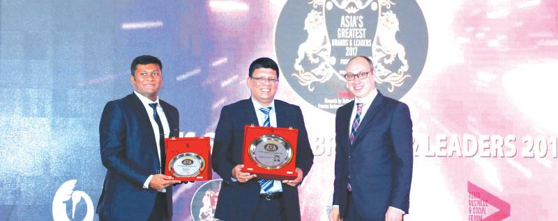 From left: Head of IT and Brand, Blue Ocean, K. Nimeshanan, Group  Chairman, Blue Ocean, S. Thumilan and Ambassador Extraordinary and Plenipotentiary of Ukraine in Singapore, Dmytro Senik at  the awards ceremony.