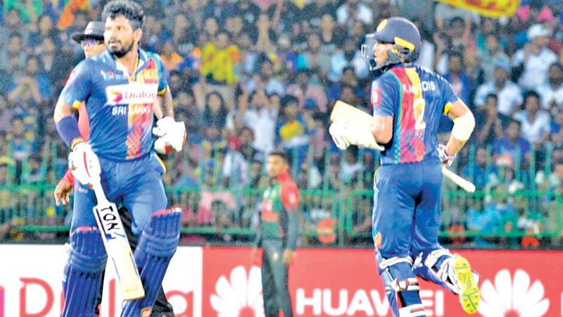 Kusal Perera and Kusal Mendis batting during their 85 runs partnership for the second wicket in the Hero Nidahas T20 match against Bangladesh at the R Premadasa Stadium yesterday. (Pic by SAMAN MENDIS)