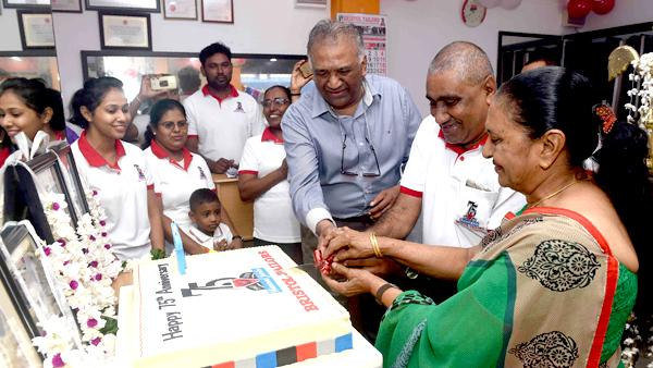 Here Chaandana Wijesekera (Centre) cuts the cake along with Tony Wickremasinghe and Olga Perera, two of the children of founder, the late Vincent Charles Wickremasinghe