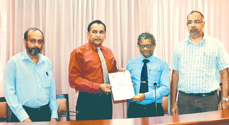 The exchange of the MoU: From left - Prof. Manjula Fernando (Head/Electrical and Electronic Engineering, University of Peradeniya),  Prof. Upul B. Dissanayake (Vice Chancellor, University of Peradeniya), Tilak de Silva (Chief Business Innovation Officer - SLT) and Dr. G.B.B. Herath (Acting Dean, Faculty of Engineering - University of Peradeniya).
