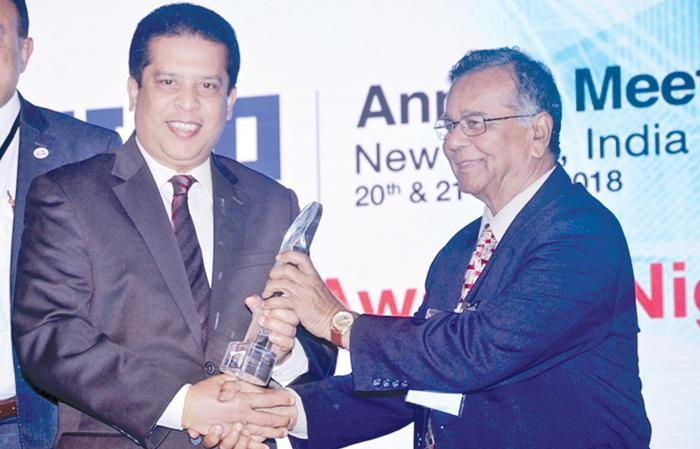 "Lakshman Silva,  CEO, DFCC Bank receiving the award for the ""Best Annual Report"" from Dr. Sailendra Narain, Honorary Member, ADFIAP at the 41st Annual Meeting of ADFIAP."