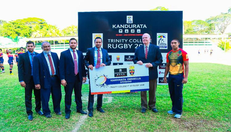 MM Rizlan (left- Finance Manager), RizaThahir (deputy general manager), MT Naufal (MD) and MTM Nawshad (Chairman Kandurata Umbrella Industries) handing over the rugby sponsorship to Trinity College principal Andrew Fowler Watt as team captain Avishka Sheik looks on