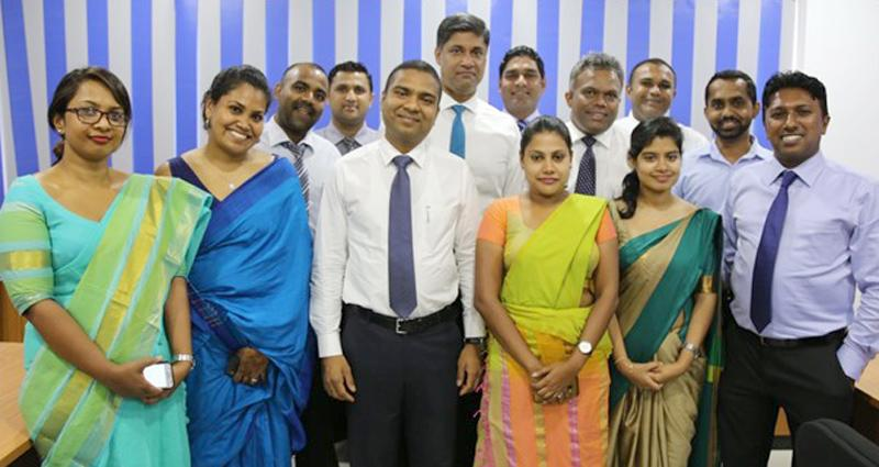 CEO of First Capital, Senior Manager Branch Operations and senior staff members at a Branch opening.