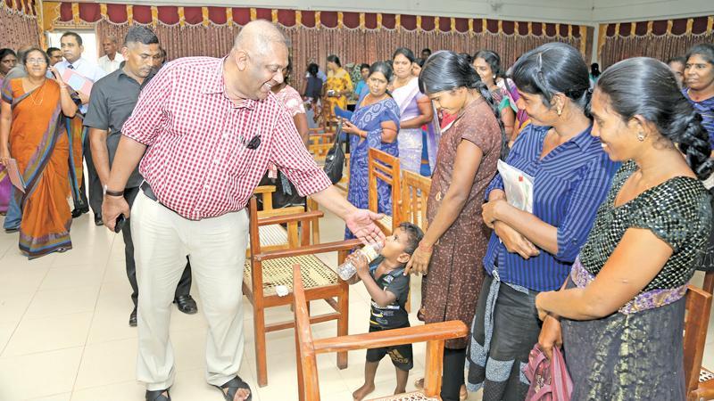 Minister Mangala Samaraweera met women's groups at the Puthukudiyirippu Divisional Secretariat yesterday