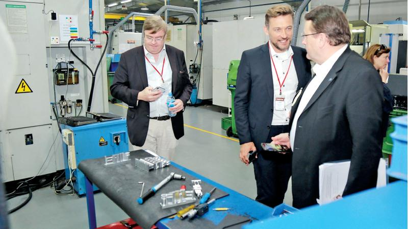 Members of the EU Parliamentary delegation at a factory