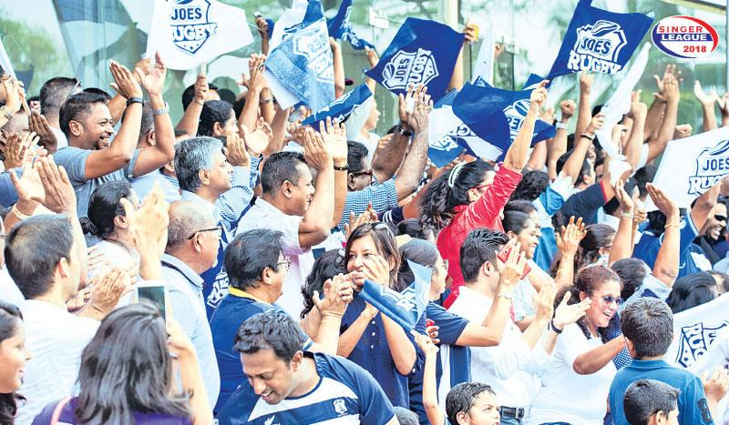 Fans of St. Joseph's College cheer their team against Royal College last week at Havelock Park.  Pic courtesy: papare.com