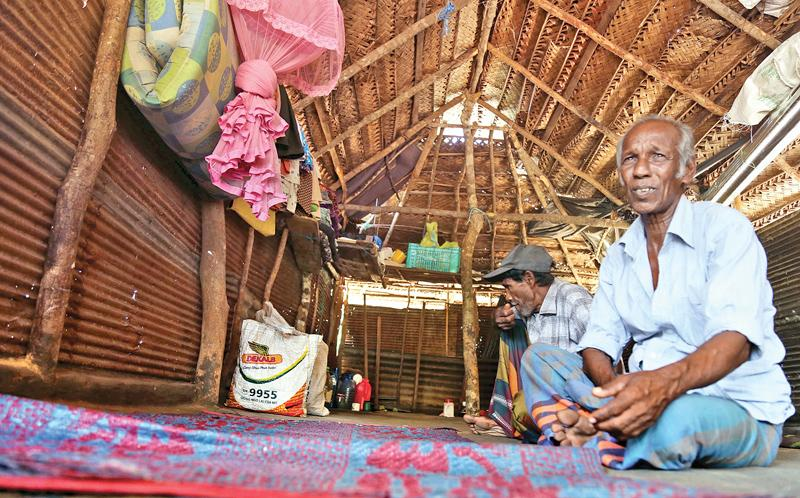 Gunawardena Heennilame has rebuilt his house in Ragamwela on land now occupied by the Air Force   (Pix: Rukmal Gamage)