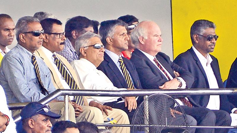 Prime Minister Ranil Wickremasinghe witnesses the Bradby Shield rugby match between Royal College and Trinity College along with the heads of both schools BA Abeyratne (Royal) and Andrew Fowler-Watt (Trinity) and new sports minister Faizer Mushtapha at the Royal Sports Complex ground yesterday (Pic by Saman Mendis)