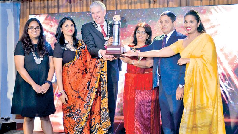 A winning team with the award