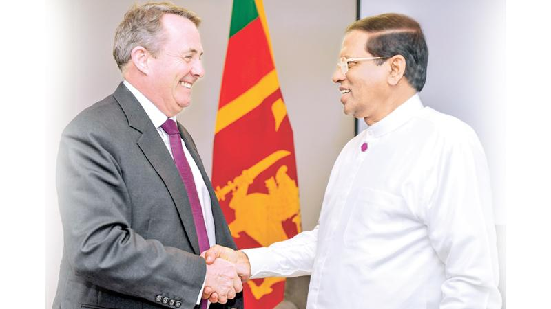 President Maithripala Sirisena with Britain's Secretary of State for International Trade, Liam Fox  in London.