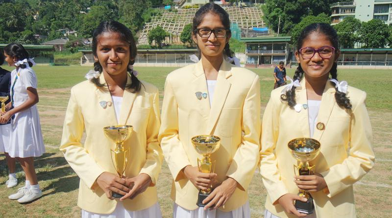 Captains of the netball champions of Hillwood College, from left Under-20 captain Thirani Welianga, Under-18 captain Jayathri Wijewardena and Under-16 captain Puthra Devadasan