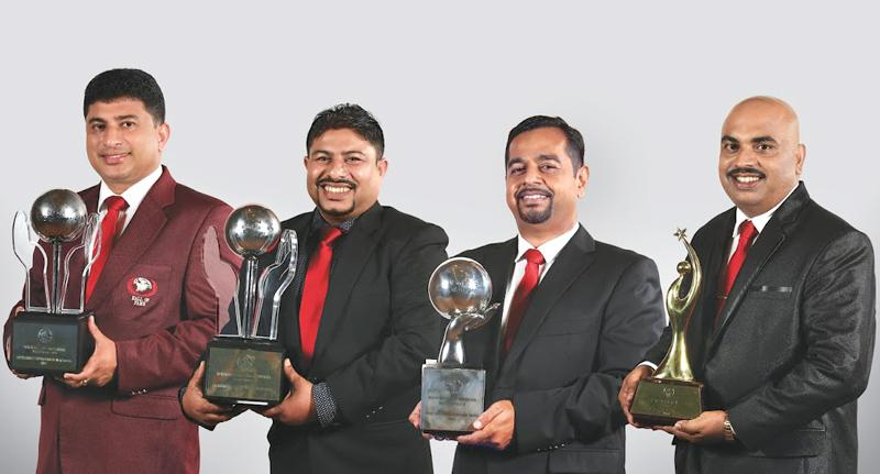 From left: Dileepa Ameendra (Best Area Development Manager), N. W. N. Senarathna Bandara (Best Wealth Planners' Manager), Ravinda Dharmasena (Best Distribution Manager) and Sarath Jayalal (Best Wealth Planner).