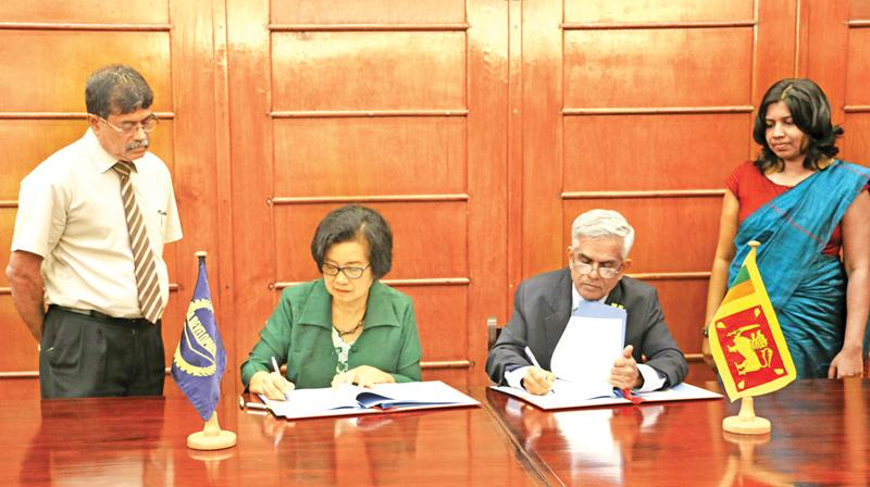 ADB Country Director, Sri Lanka Resident Mission, Sri Widowati and Secretary to the Treasury, Ministry of Finance and Mass Media, Dr. R.H.S. Samarathunga sign the agreement